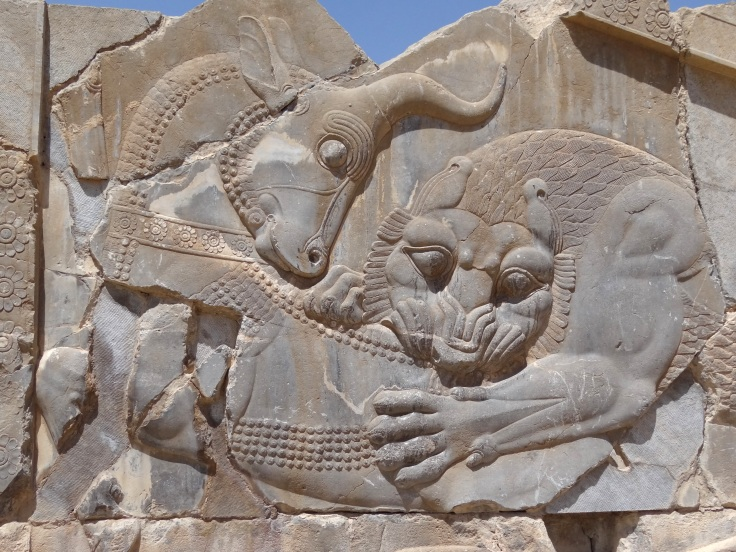 Bas-Relief_of_Lion_Attacking_Bull_-_Persepolis_-_Central_Iran_(7427804180)